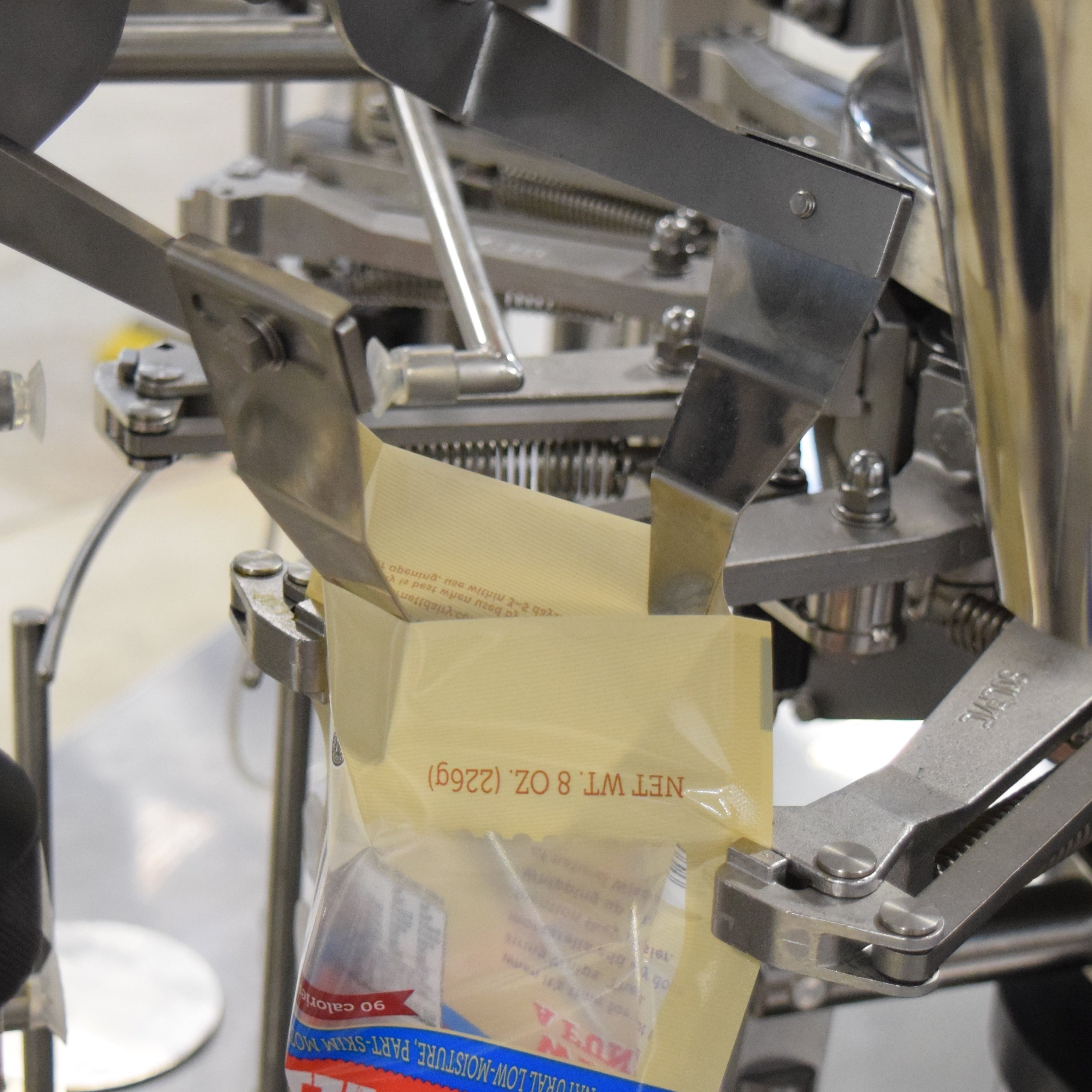 Premade_Pouch_Packaging_Machine_Bag_Opening_SImplex-707409-edited.jpg